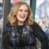 Adele a sarutat un fan in timpul unui concert (video)